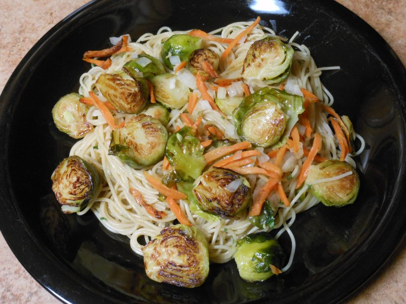 Pasta with Brussels Sprouts, Onion and Carrot in seasoned oil food - © Briana Blair