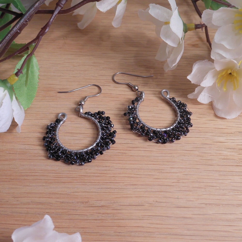 Formed Wire Earrings Hoops Black and Hematite Beads Woven Around