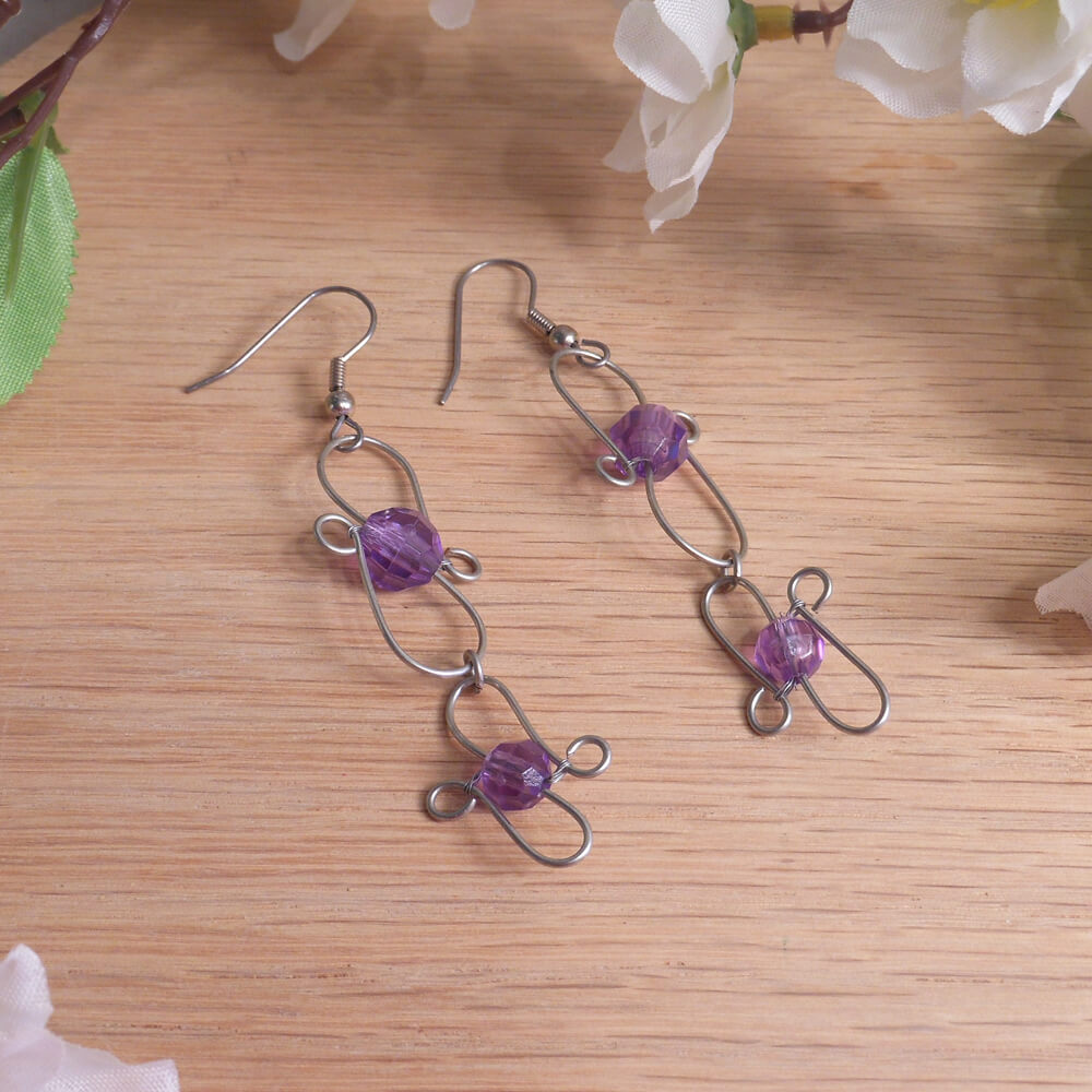 Purple Faceted Double Swirl Hook Earrings