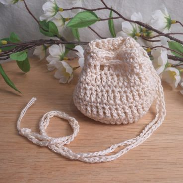 Rune Bag Cream White Crocheted Elder Futhark Glass Runestones Talisman Bag closed