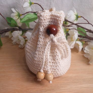 Rune Bag Cream Crocheted Elder Futhark with Wood Beads White Runestones Talisman Bag closed