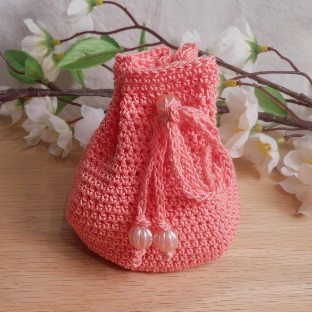 Rune Bag Peach Crocheted Elder Futhark with Round Beads Peach Runestones Talisman Bag closed