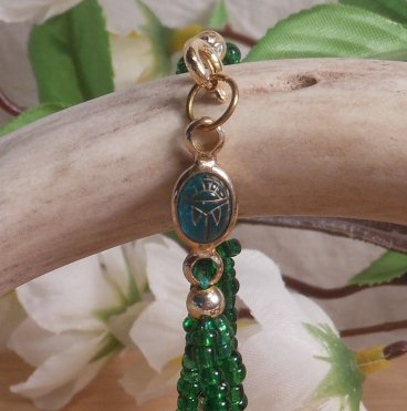 Bracelet Scarab and Three Strand Braided Beads Green close