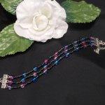 Iridescent Triple Strand Bracelet and Dangle Earrings Set