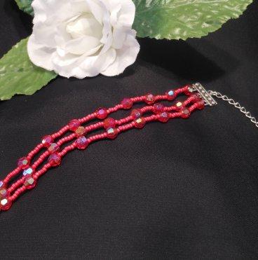 Red Triple Strand Bracelet and Dangle Earrings Set