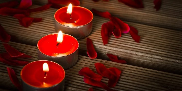 red candles fire flame magic spell ritual pagan