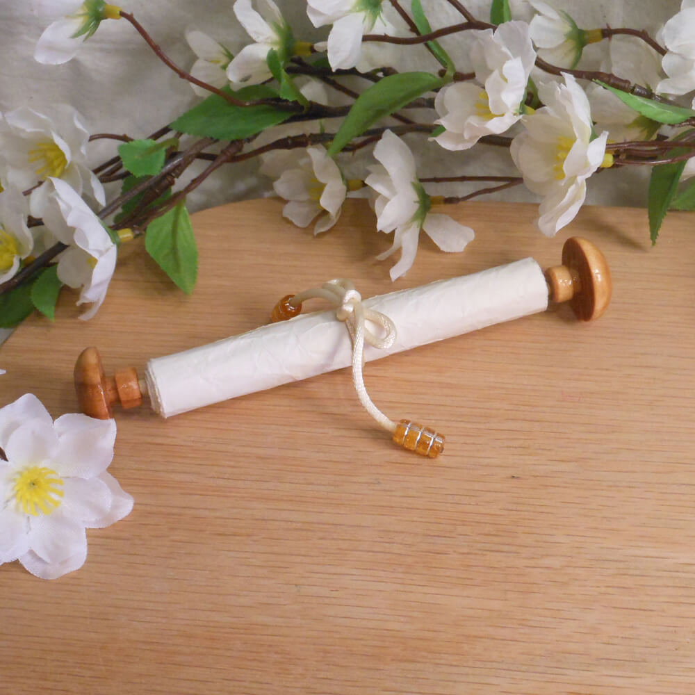 Wood Capped Scroll with White Satin Tie and Orange Beads