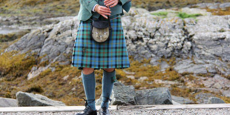 man skirt kilt standing legs bagpipe